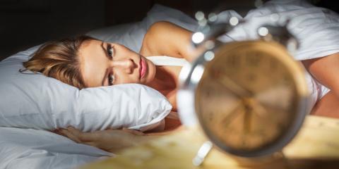 Frau mit stressbedingten Schlafstörungen