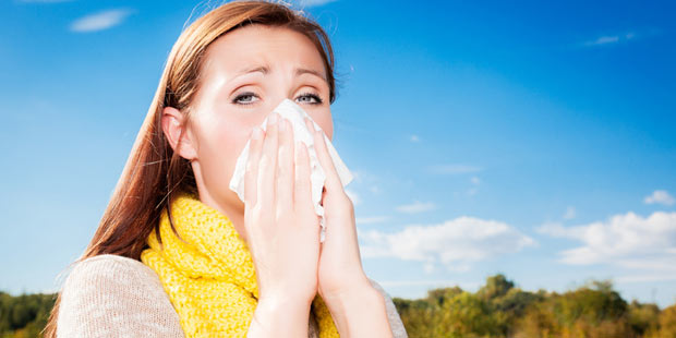 Frau mit Sommergrippe